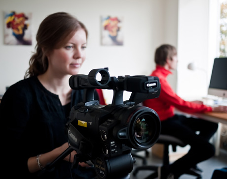 Woman working with video camera